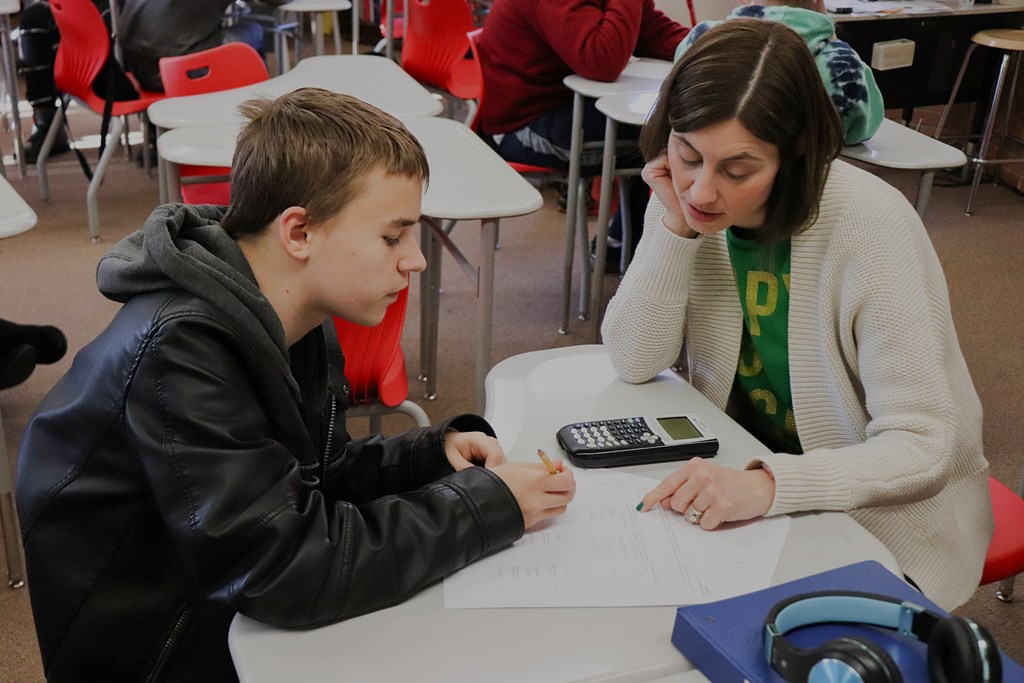 Teacher helping student with problem