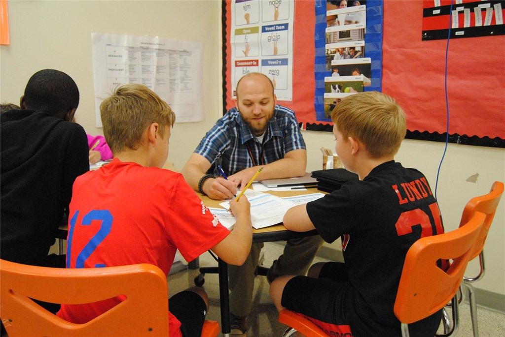 Mr. Woleslagle works with students.