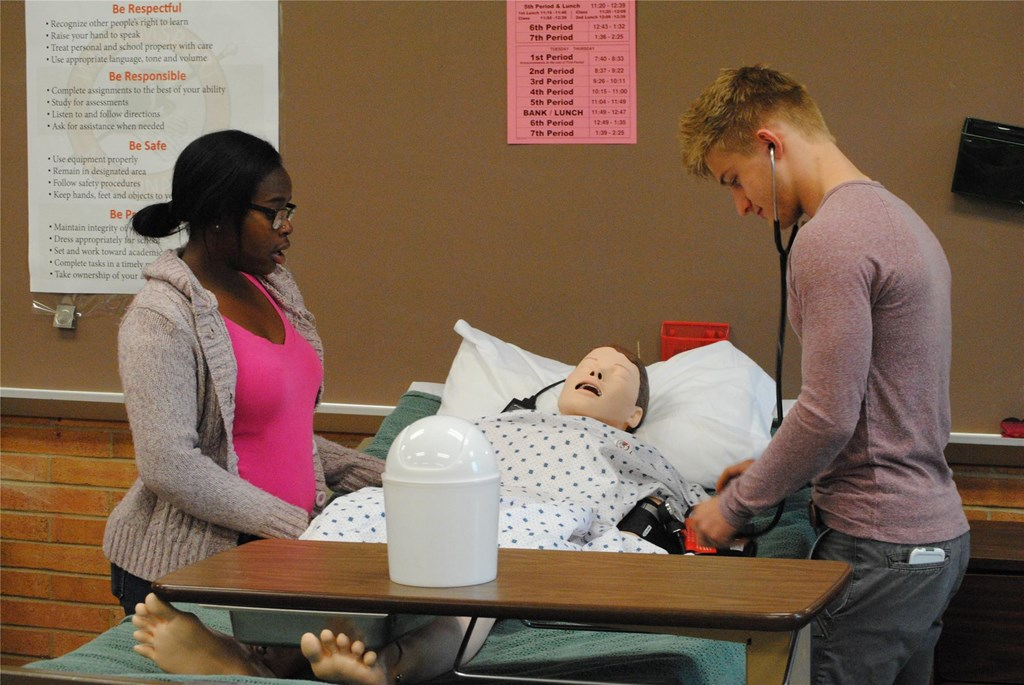 Health occupations students work on
