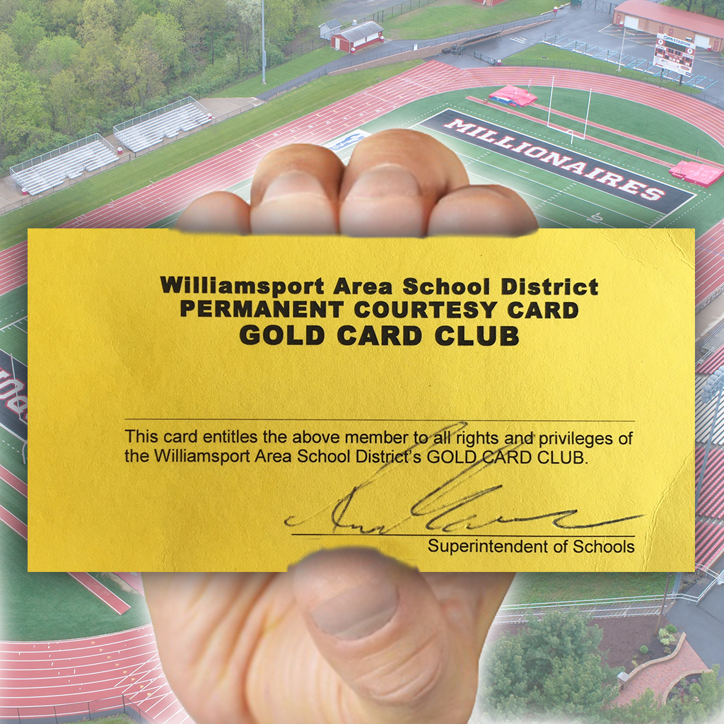 A hand grasps an example of WASD's Gold Card.