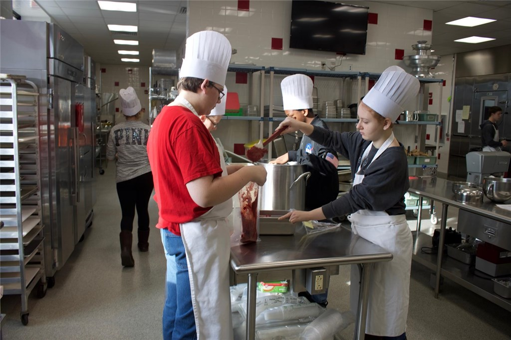 Culinary Students cooking in kitchen