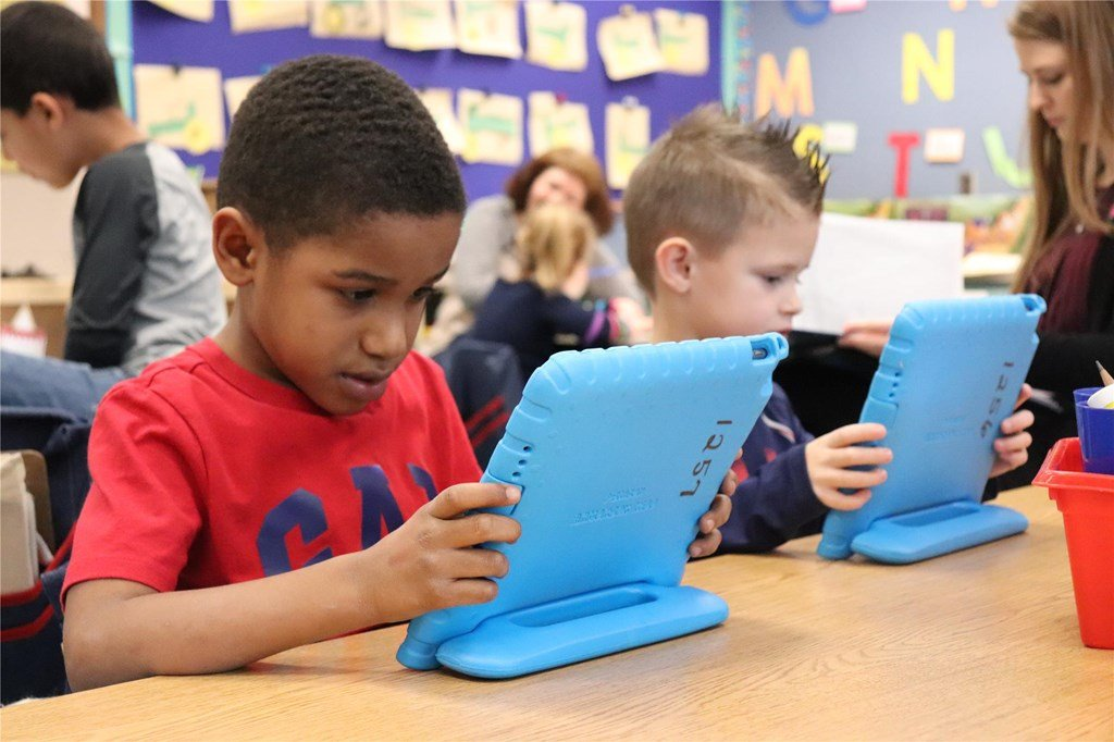 Two boys using tablets