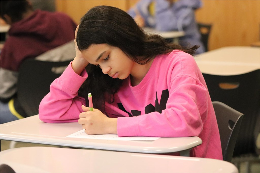 Student works on a math test.