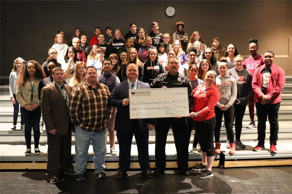 Students present check to WBP.