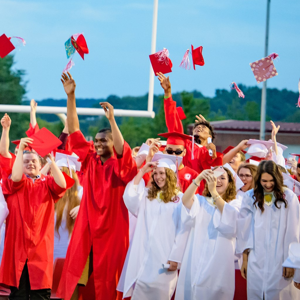 WAHS graduates throwing caps in air